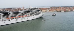 Cruise ship in the Venice Lido dwarfing the city behind.
